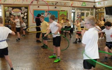 Y5 have fun hula hooping to raise funds!